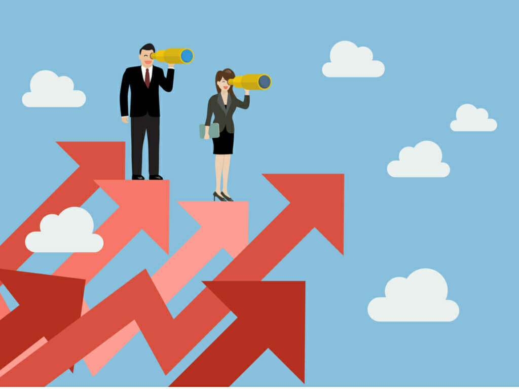 Business man and woman have a telescope standing on graph up looking at recruitment trends